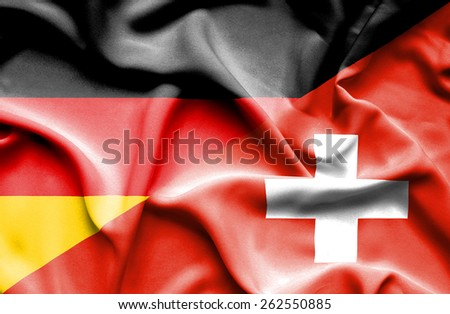 Waving flag of Switzerland and Germany - stock photo