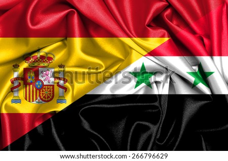 Waving flag of Syria and Spain - stock photo