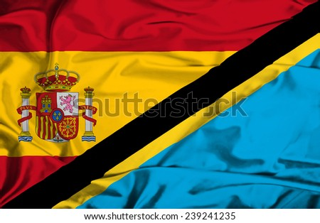 Waving flag of Tanzania and Spain