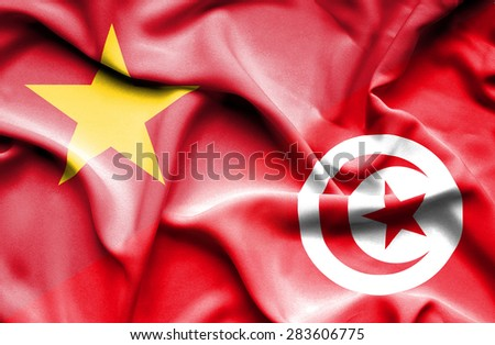 Waving flag of Tunisia and Vietnam