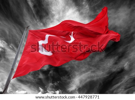 Waving flag of Turkey against black and white storm sky - stock photo