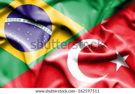 Waving flag of Turkey and Brazil - stock photo