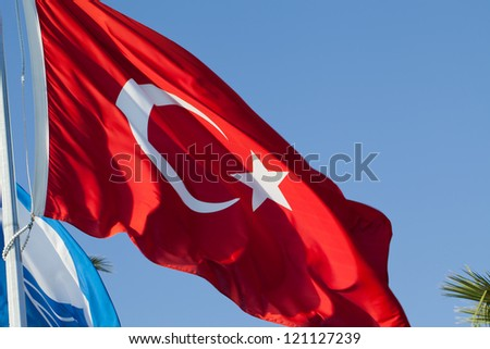 Waving flag of Turkey under blue sky