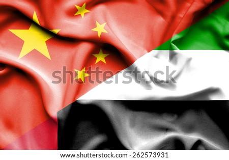 Waving flag of United Arab Emirates and China - stock photo