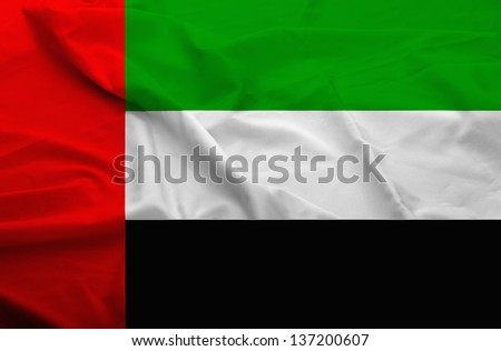 Waving flag of United Arab Emirates. Flag has real fabric texture.