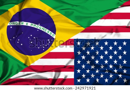 Waving flag of United States of America and Brazil - stock photo