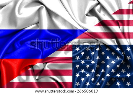 Waving flag of United States of America and Russia - stock photo