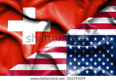 Waving flag of United States of America and Switzerland - stock photo