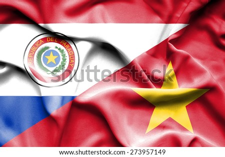 Waving flag of Vietnam and Paraguay