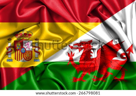 Waving flag of Wales and Spain - stock photo