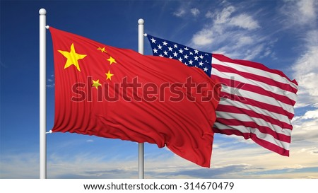 Waving flags of China and USA on flagpole, on blue sky background. - stock photo