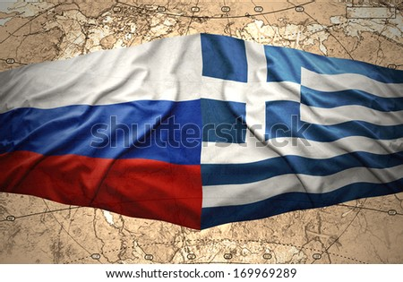 Waving Greek and Russian flags on the background of the political map of the world - stock photo