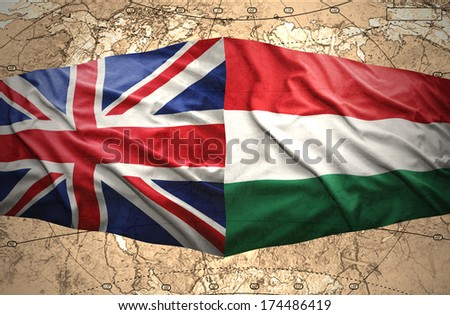 Waving Hungarian and British flags of the political map of the world - stock photo