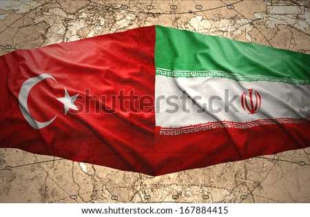 Waving Iranian and Turkish flags on the background of the political map of the world - stock photo