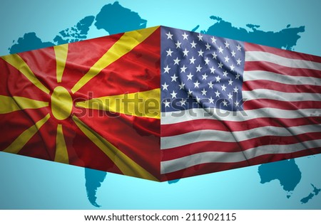 Waving Macedonian and American flags of the political map of the world - stock photo