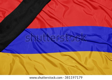 waving national flag of armenia with black mourning ribbon  - stock photo