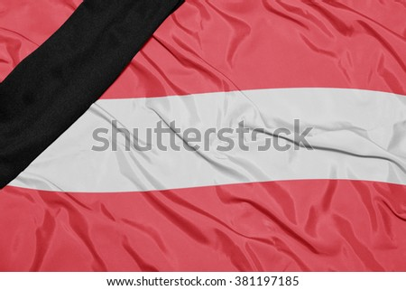waving national flag of austria with black mourning ribbon  - stock photo