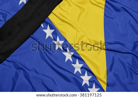 waving national flag of bosnia and herzegovina with black mourning ribbon  - stock photo