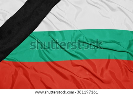 waving national flag of bulgaria with black mourning ribbon  - stock photo