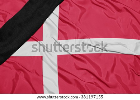 waving national flag of denmark with black mourning ribbon  - stock photo