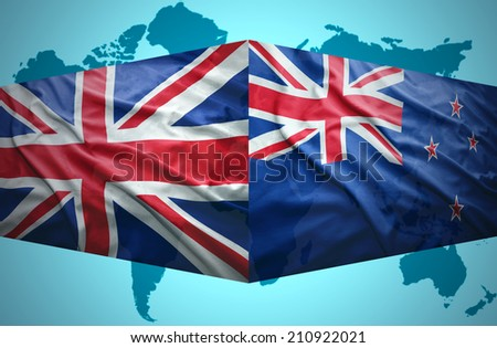Waving New Zealand and British flags of the political map of the world