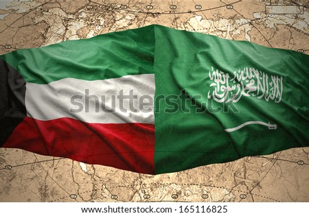 Waving Saudi Arabia and Kuwait flags on the background of the political map of the world