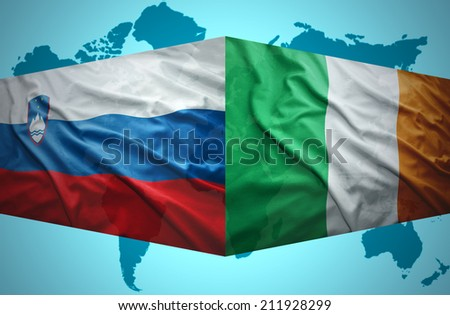 Waving Slovenian and Irish flags of the political map of the world