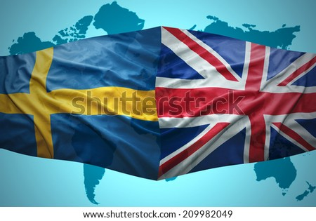 Waving Swedish and British flags of the political map of the world - stock photo