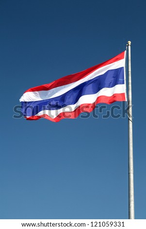 Waving Thai flag with blue sky background - stock photo