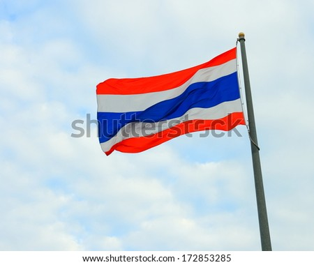 Waving Thailand flag with blue sky background  - stock photo