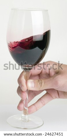 Waving the red wine - stock photo
