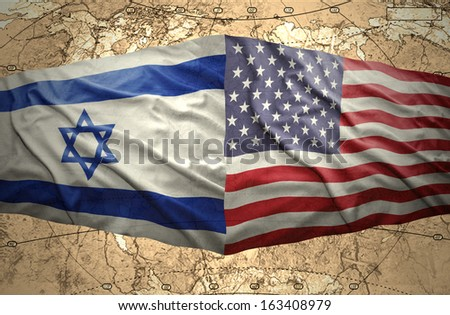 Waving United States of America and Israeli flags on the background of the political map of the world - stock photo