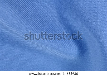 Wavy and beautiful blue satin fabric background - stock photo