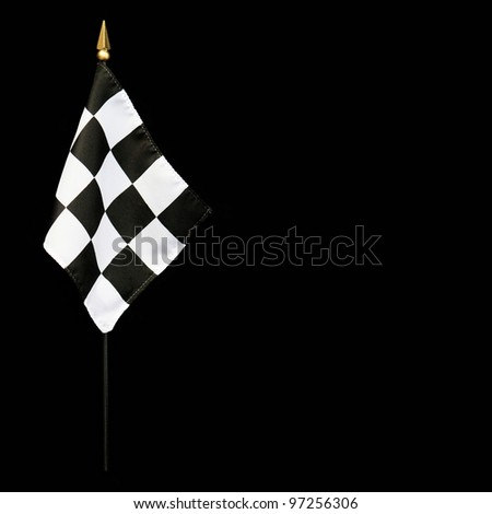 Wavy Black and White Finish Line Checkered Flag with flagpole isolated on black background with room for your text - stock photo