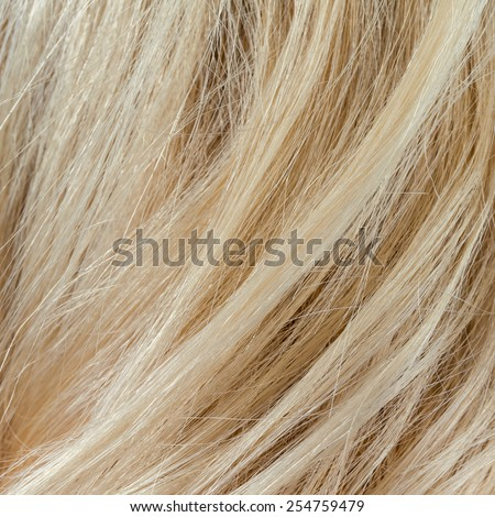 Wavy blonde woman hair background and texture - stock photo