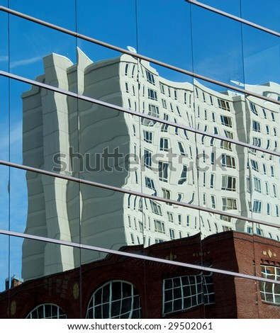 Wavy Building Reflection in Office Building Windows