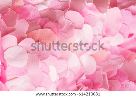 Wavy composition of spring pink petals. Flower blossom wallpaper, top view