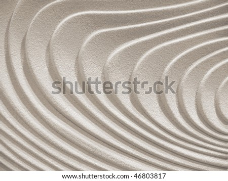 wavy curves on a sand- stone surface