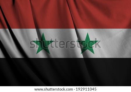 Wavy flag of Syria.  - stock photo