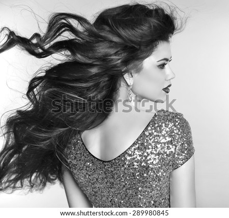 Wavy hair. Beauty fashion girl model portrait with blowing hairstyle. Sensual Lady. Black and white photo.