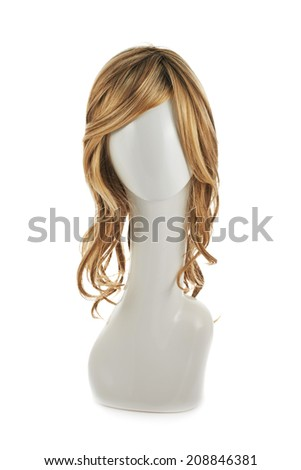 Wavy hair wig over the white plastic mannequin head isolated over the white background - stock photo