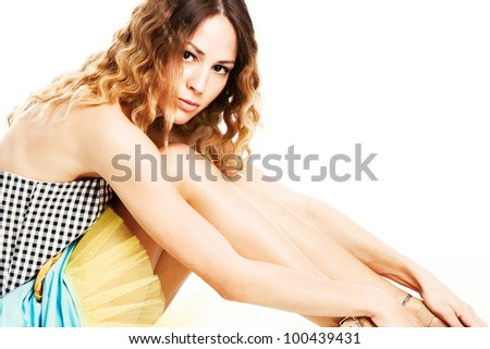 wavy hair young woman  in summer dress studio shot - stock photo