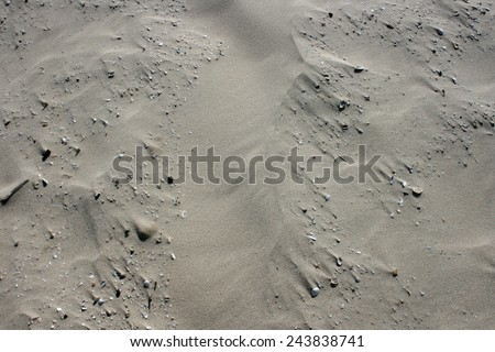 wavy pattern in beige sand
