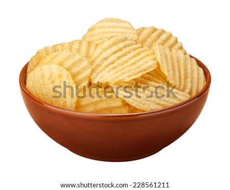 Wavy potato chips with ridges, sometimes called ruffles, in a brown ceramic bowl isolated on a white background. A salty snack associated with parties, and watching sporting events. - stock photo