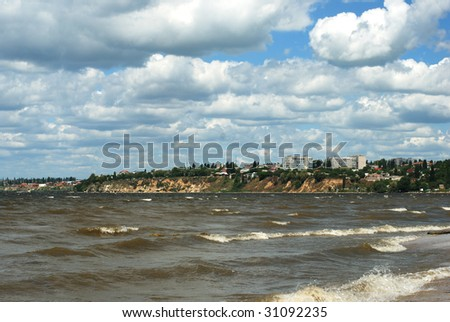 Wavy water of river over cloudy blue sky