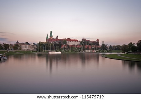 Wawel Castle in Krakow, Poland, over Vistula River at sunset - stock photo