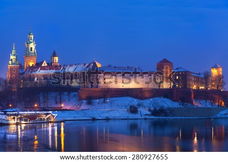 Wawel castle in night illumination in the winter. Krakow, Poland - stock photo