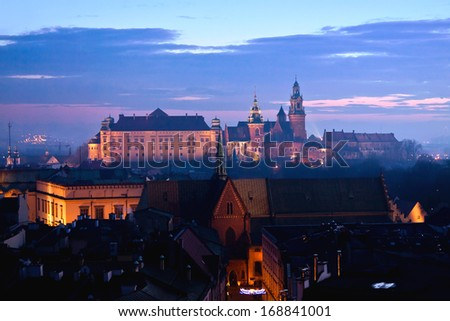 Wawel hill with castle in Krakow at night - stock photo