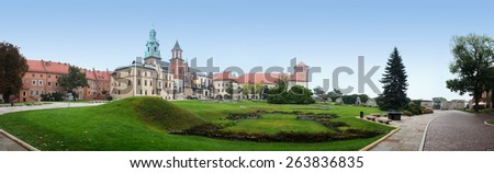 Wawel is fortified architectural complex erected over many centuries atop limestone outcrop on left bank of Vistula river in Krakow, Poland. - stock photo