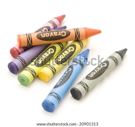 Wax crayons lined up against a white background. Art and craft background.